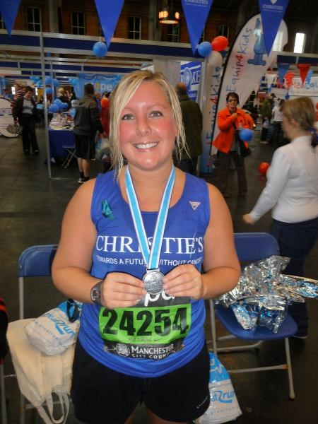 Nat with medal for completing Manchester 10k 2009