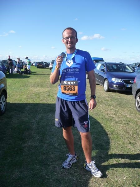 Rob with his medal after completing the 13 mile Great North Run 2009