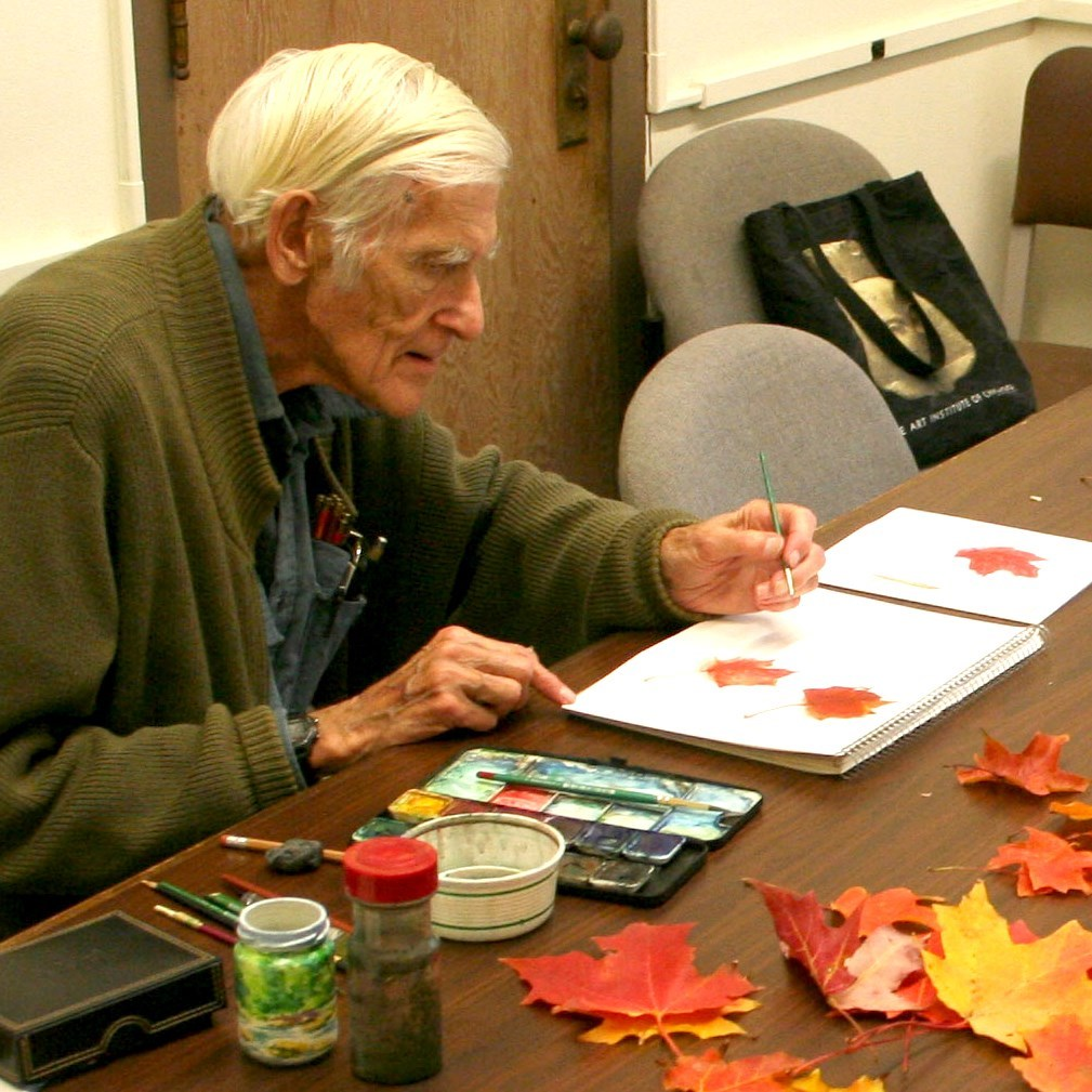 Jack painting leaves in class