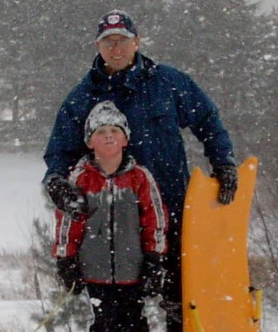 John and George Sledging in Canada