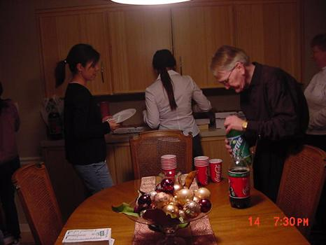 Tom McRoberts serving UMM Int'l Students during a Christmas Holiday Party in 02'