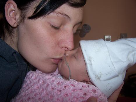 Nevaeh's mummy giving her a loving kiss xx
