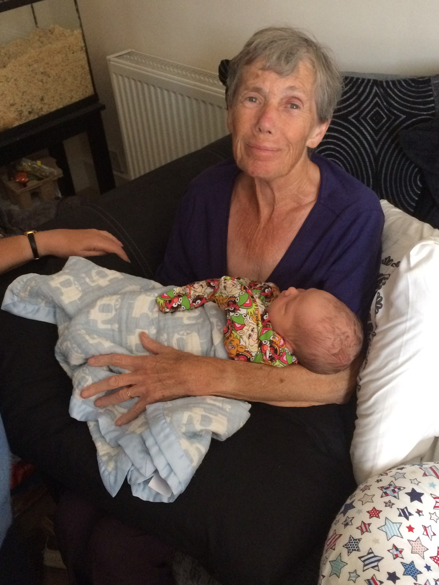 Meeting her greatgrandson Logan for the first time