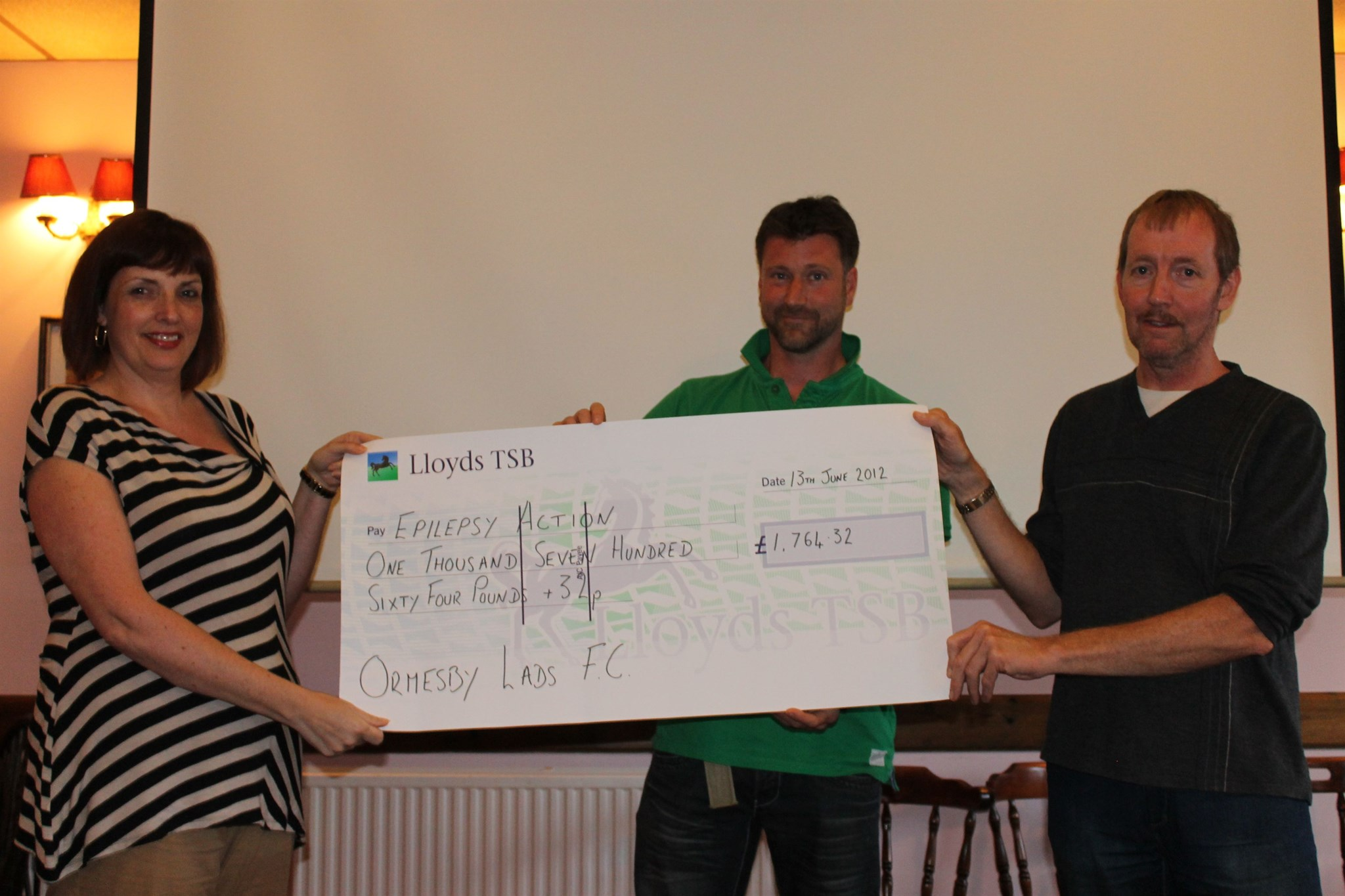 Presentation of cheque to Thomasina from Ormesby Lads FC following the 24hr marathon