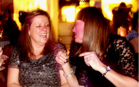 Tracey and Di share a joke.