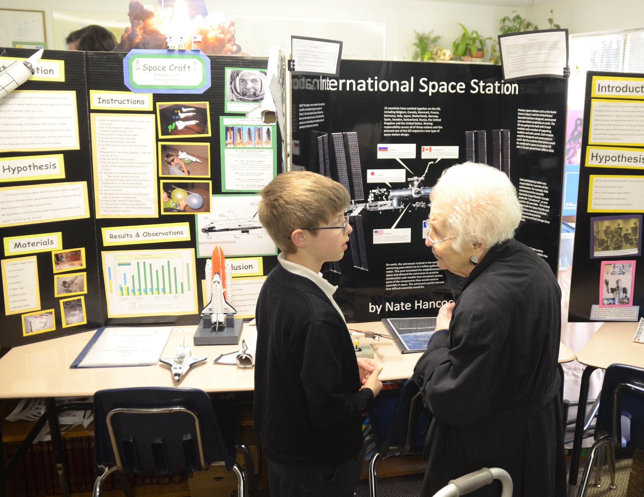 2012: Mrs. Justus talking to her Great Grandson (Nate) about his Science Fair project