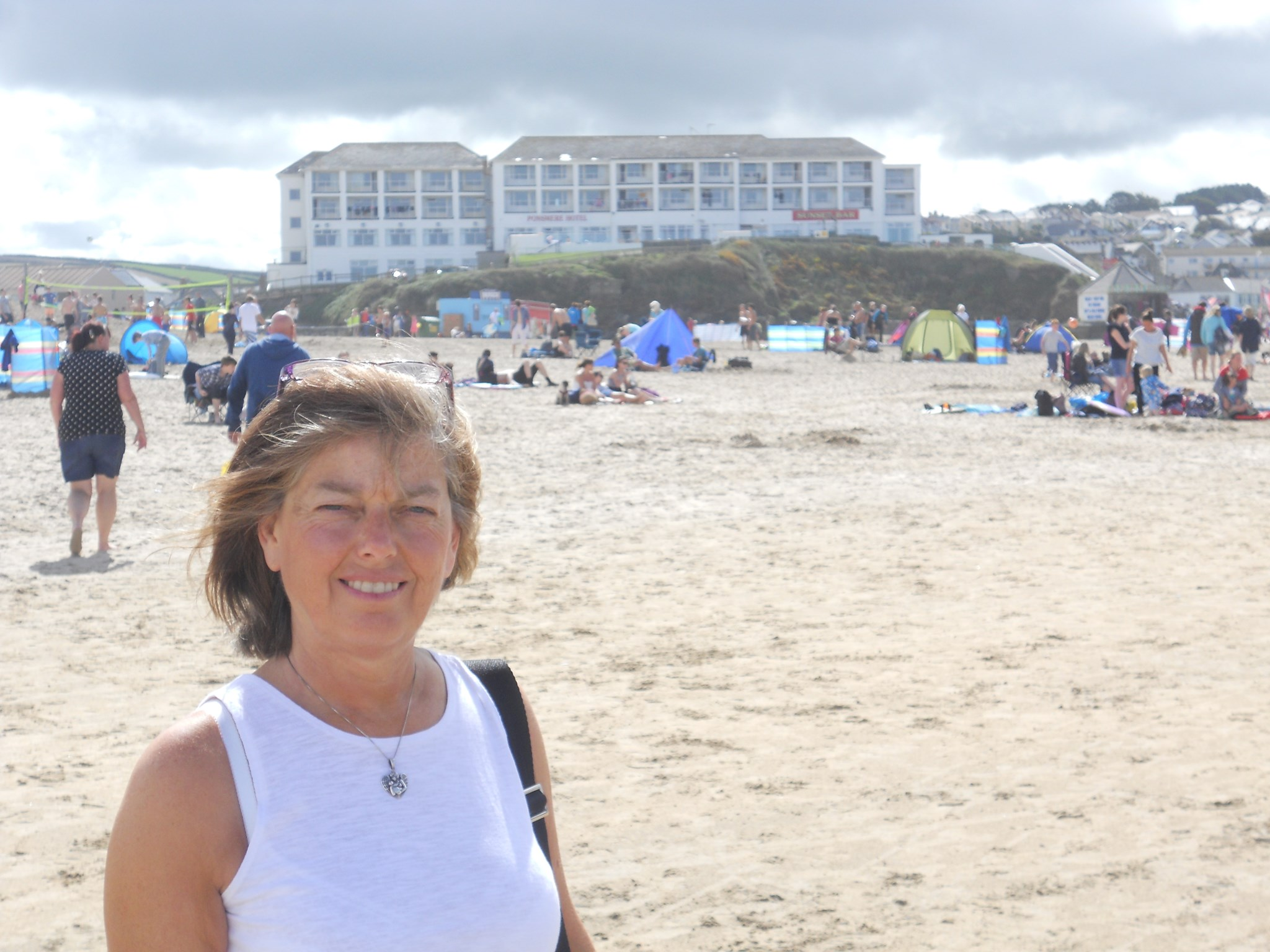 Mum on the beach with The Ponsmere Hotel in the background