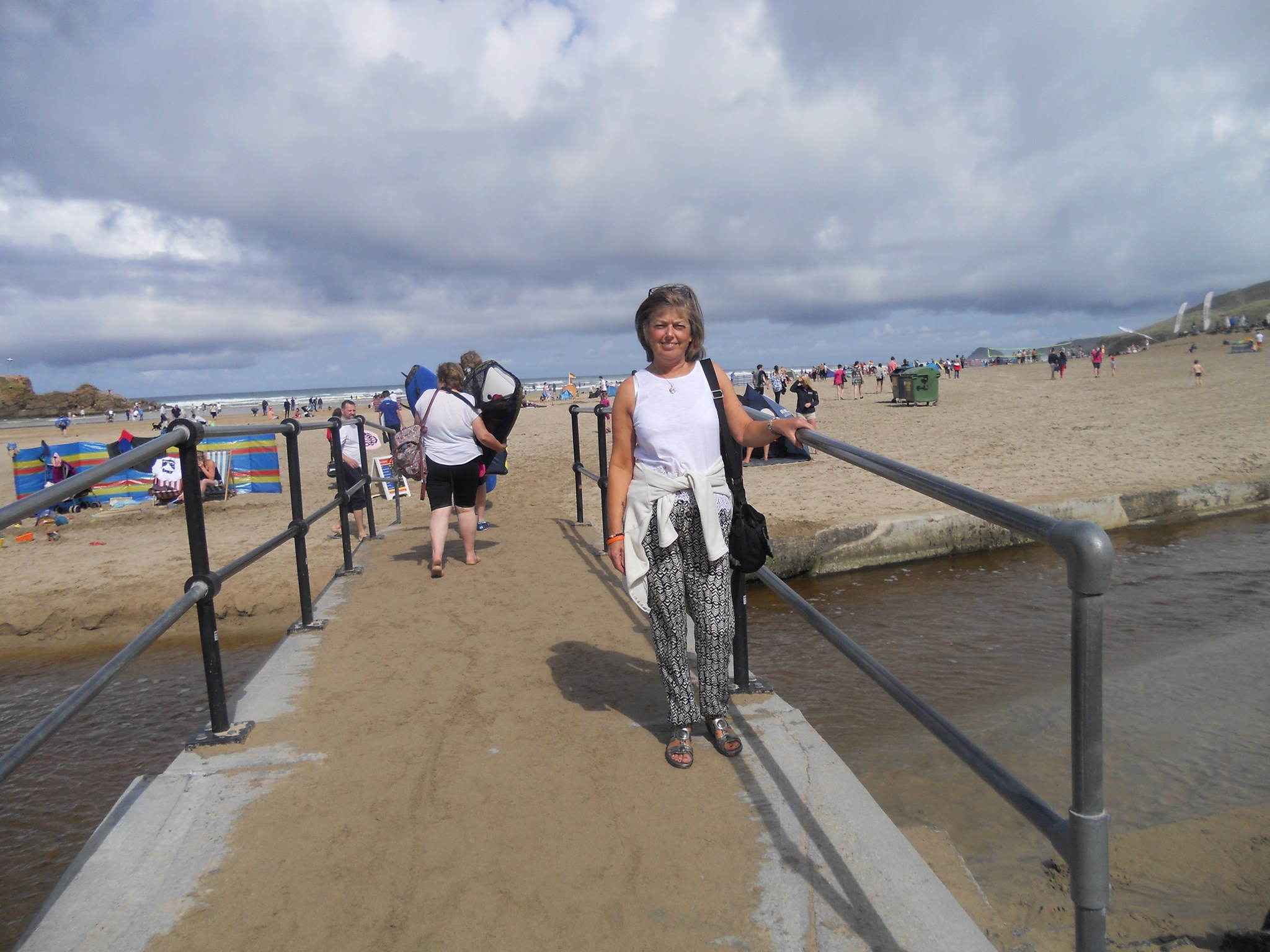 Mum crossing the bridge from the hotel to the beach