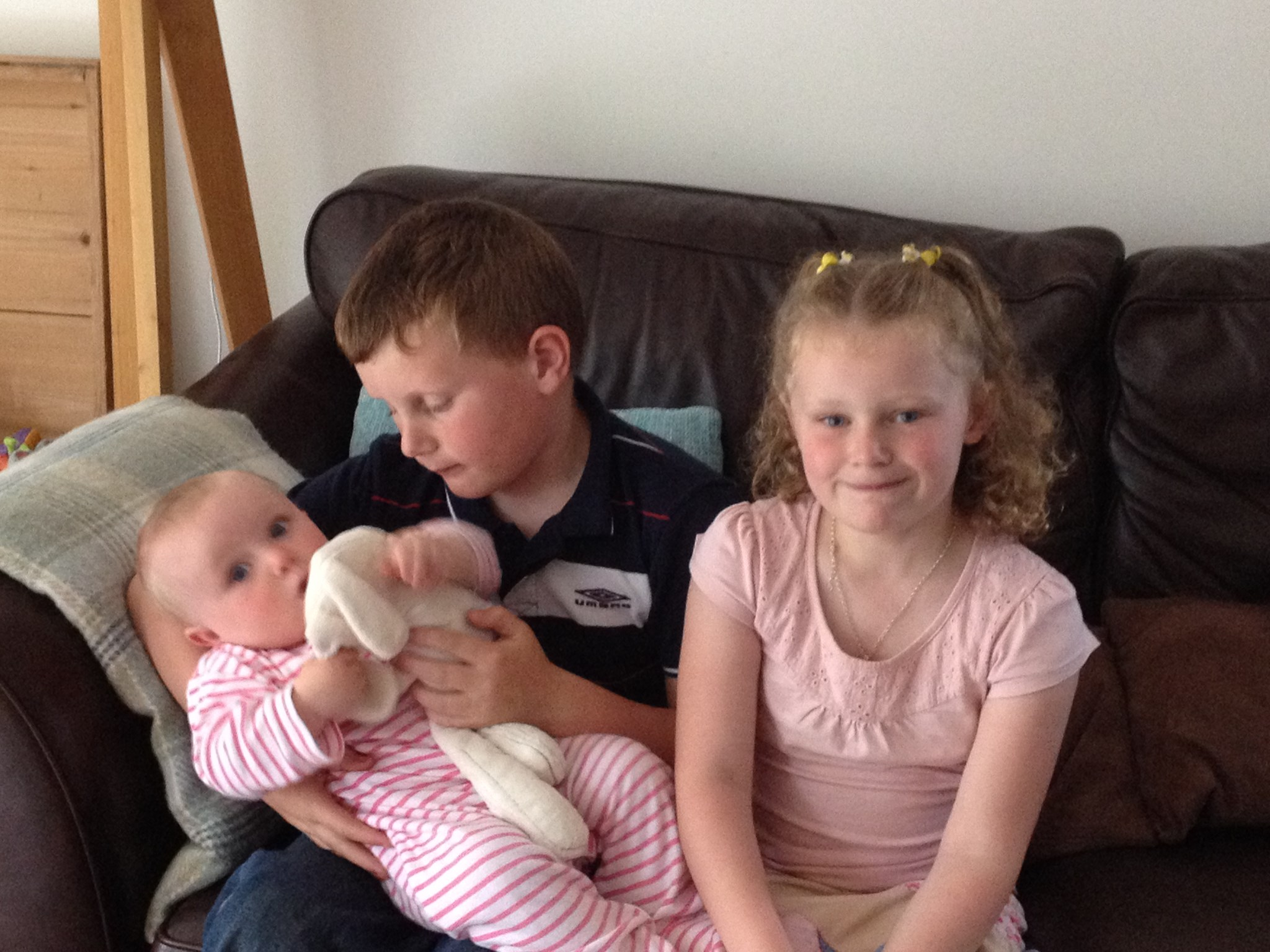 The day of Harry's 8th Birthday - 26.5.14.  Loving his sisters.