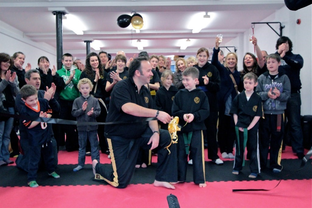 Ollie cutting the ribbon at the grand opening of our Akeman Street Dojo in 2011