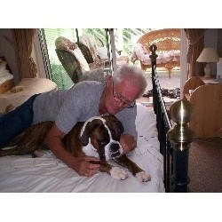 Mike with Hovis the boxer when Mike was Director of Doggie Sleepovers