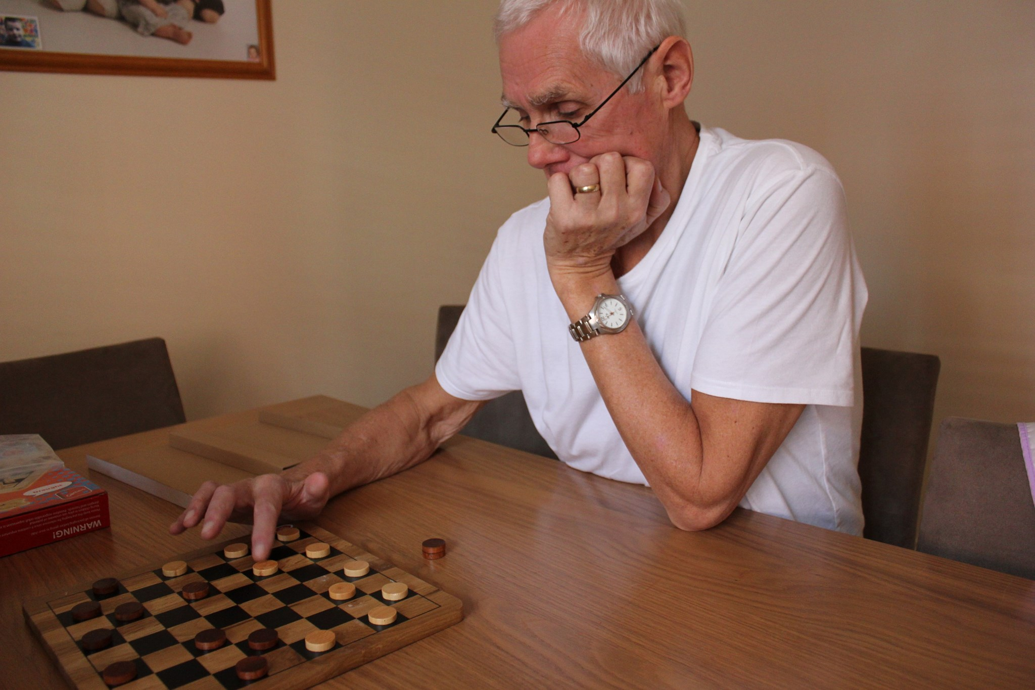 Playing Draughts with his grandson Ryan