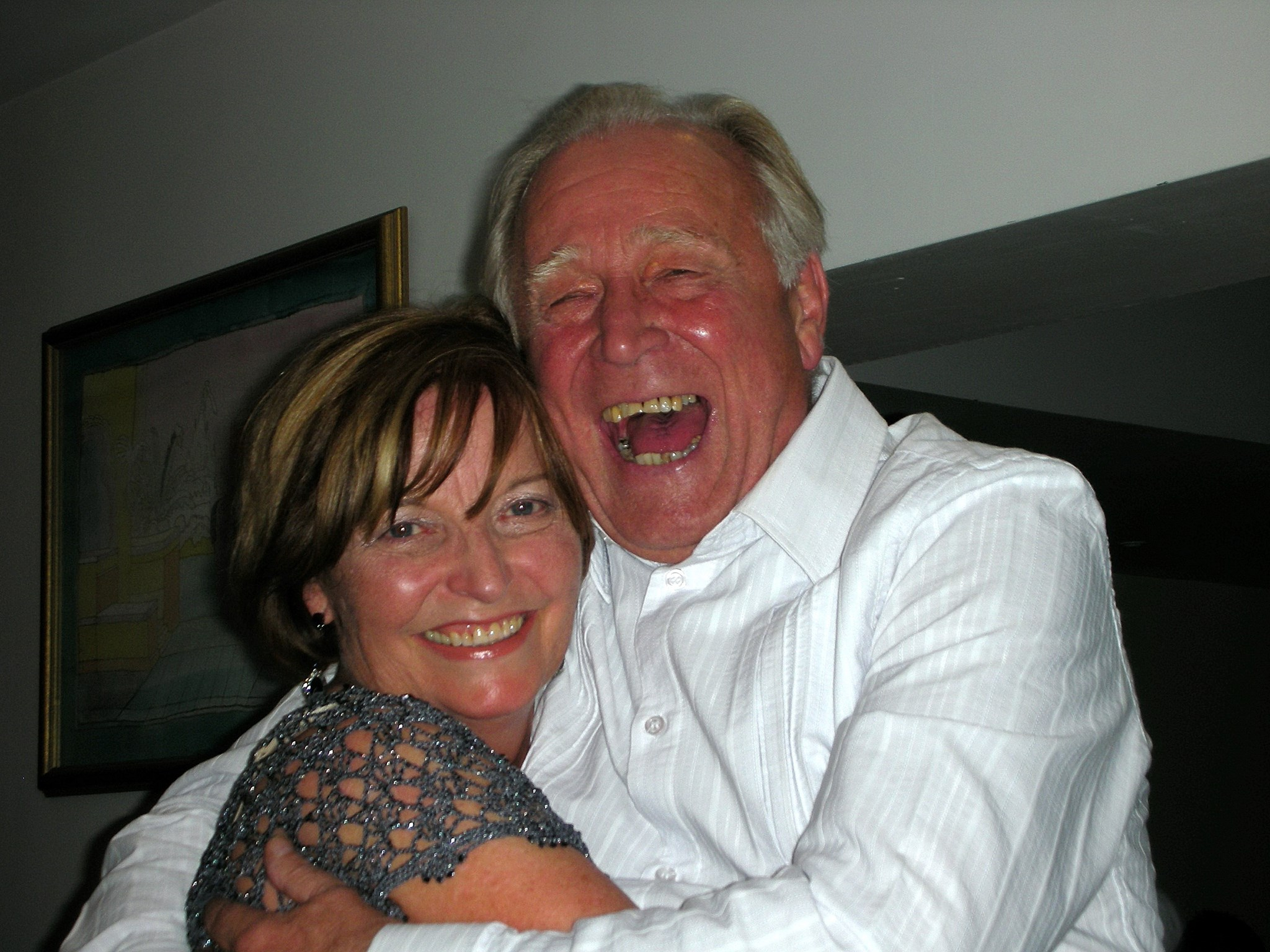 Hughie with his long time secretary Carole at his company retirement party.