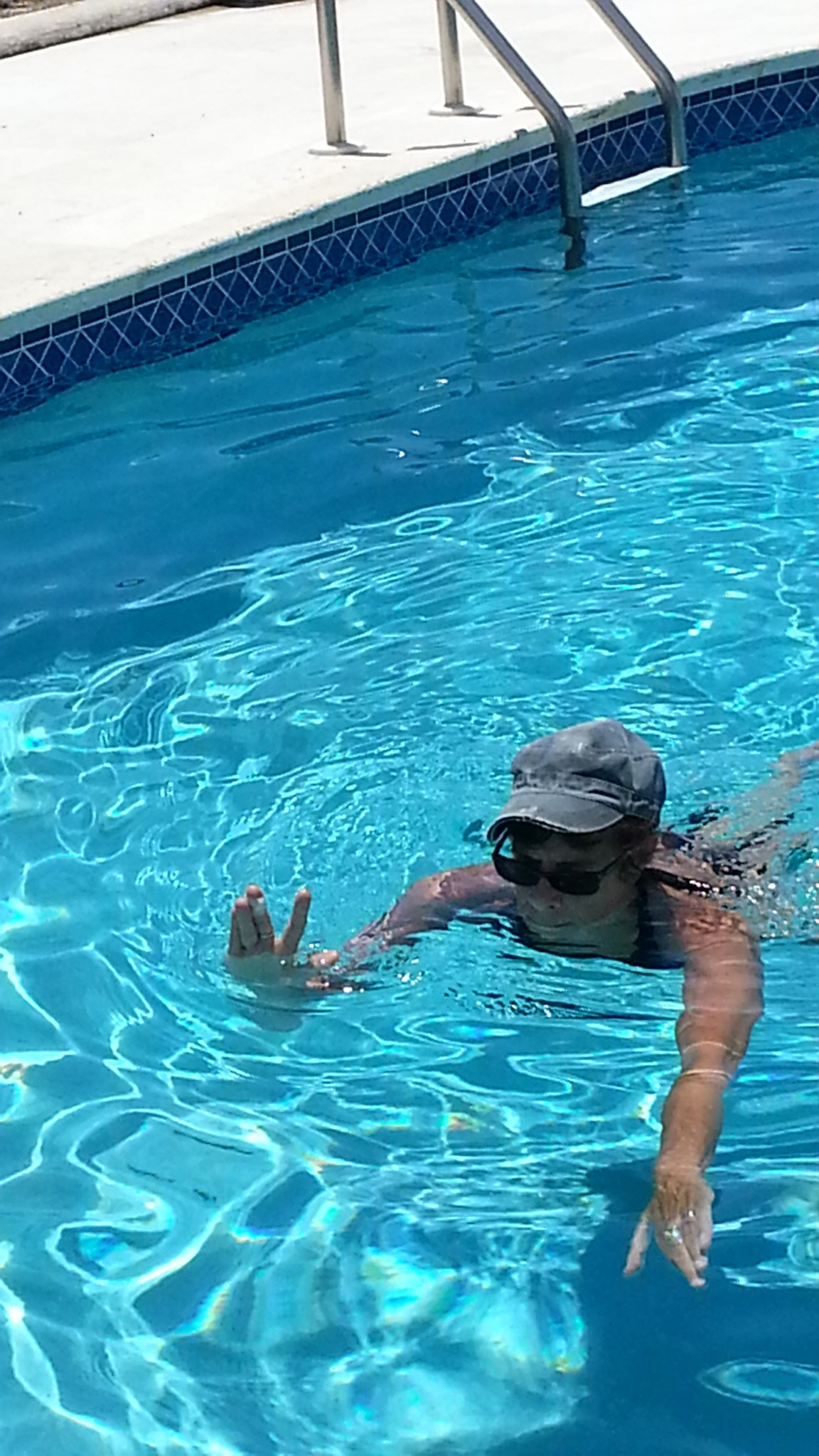 Swimming one handed.