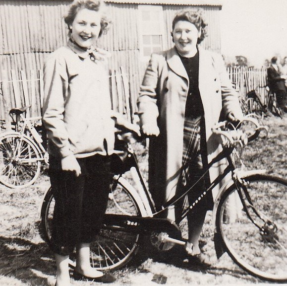 Mystery lady, Mum, and a bicycle ...