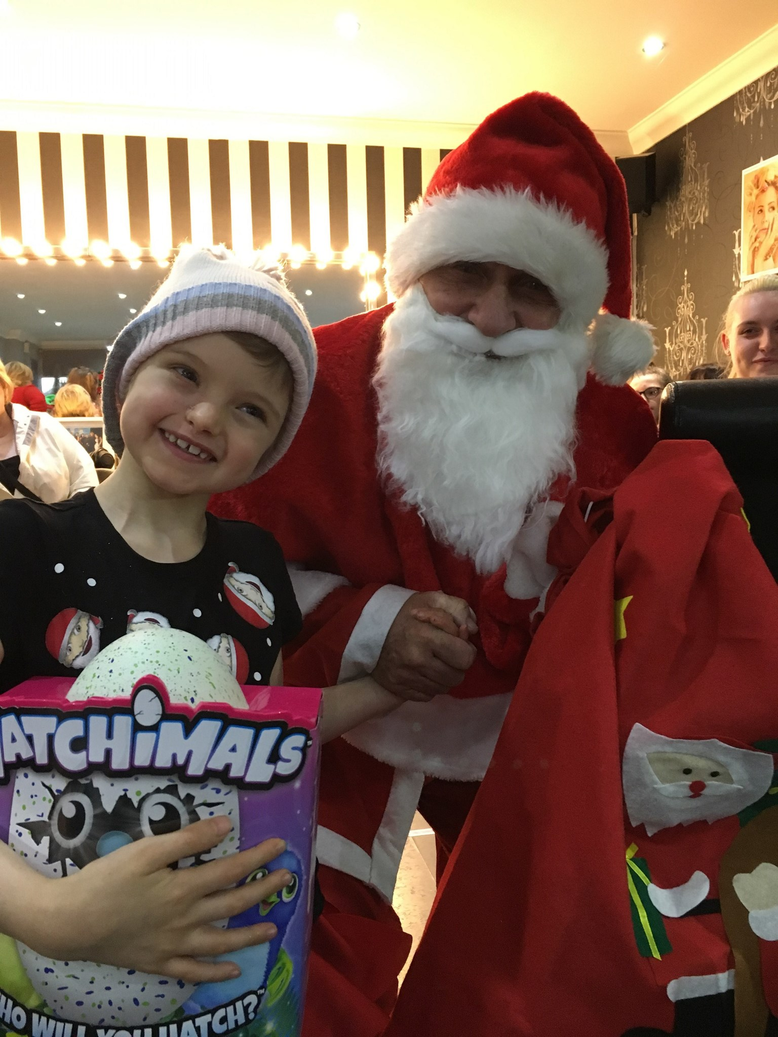 Gracie, Santa and the Hatchimal!