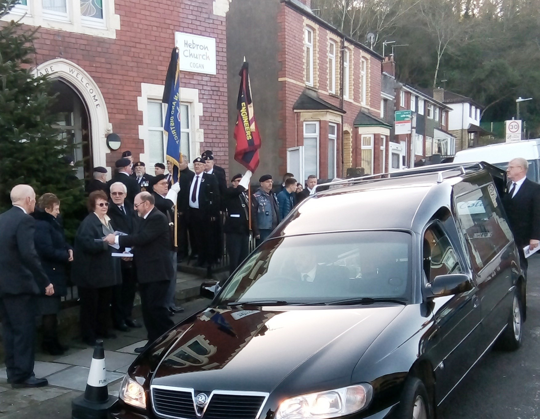 Standard bearers and vets line up either side of the entrance to the church - John's funeral today.