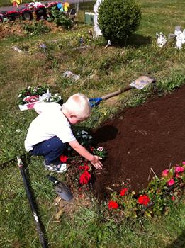 Louie looking after he's dads angel garden. xx