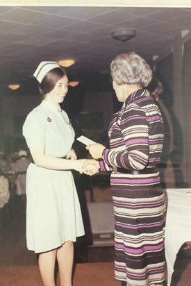 Margaret qualifying as a registered nurse.