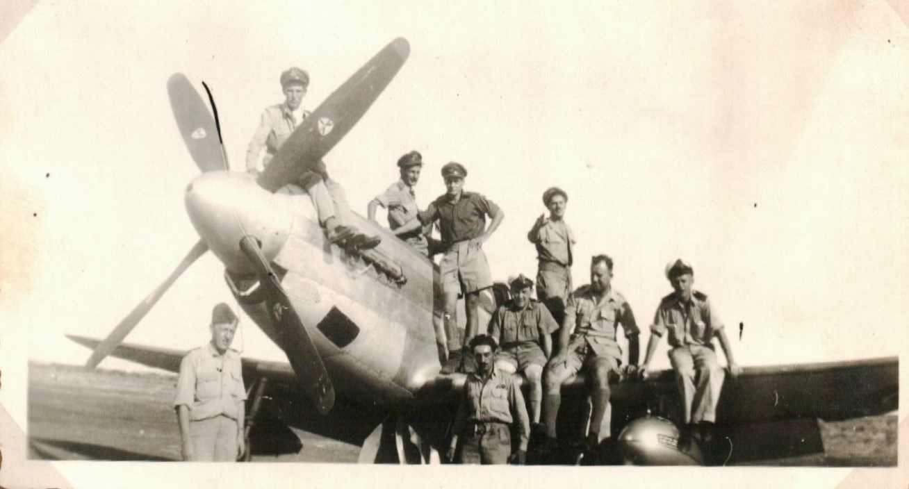 Dad (standing with black hair) and other 213 Squadron crews with a Mustang.
