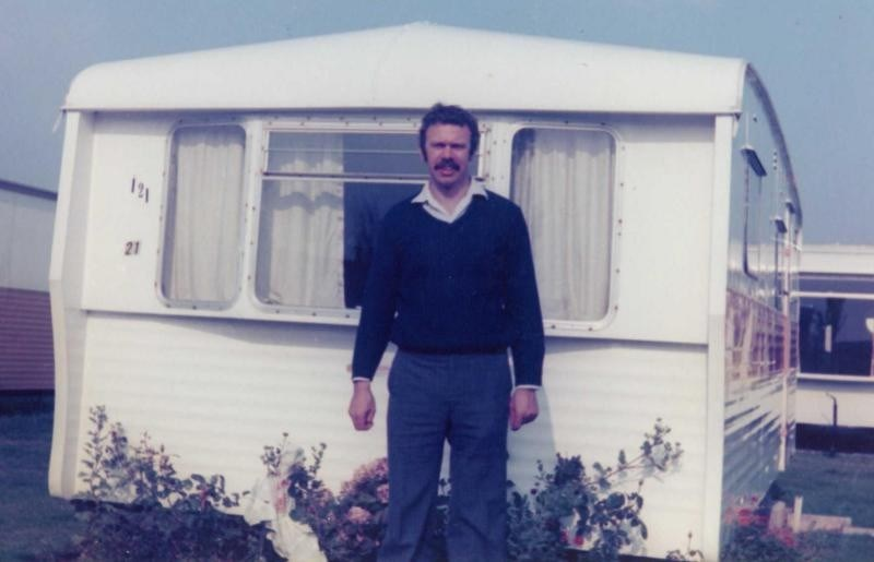 Dad standing in front of our caravan at Blue Anchor Bay