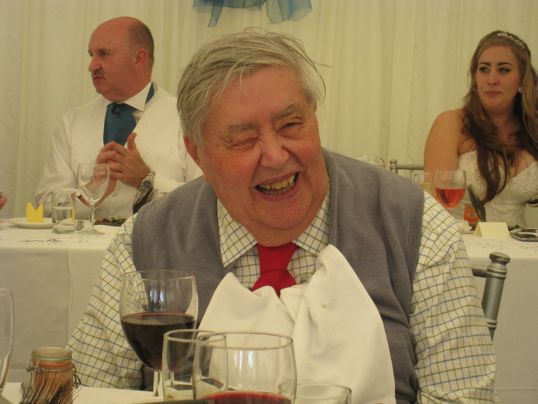 Dad laughing at Becky's wedding