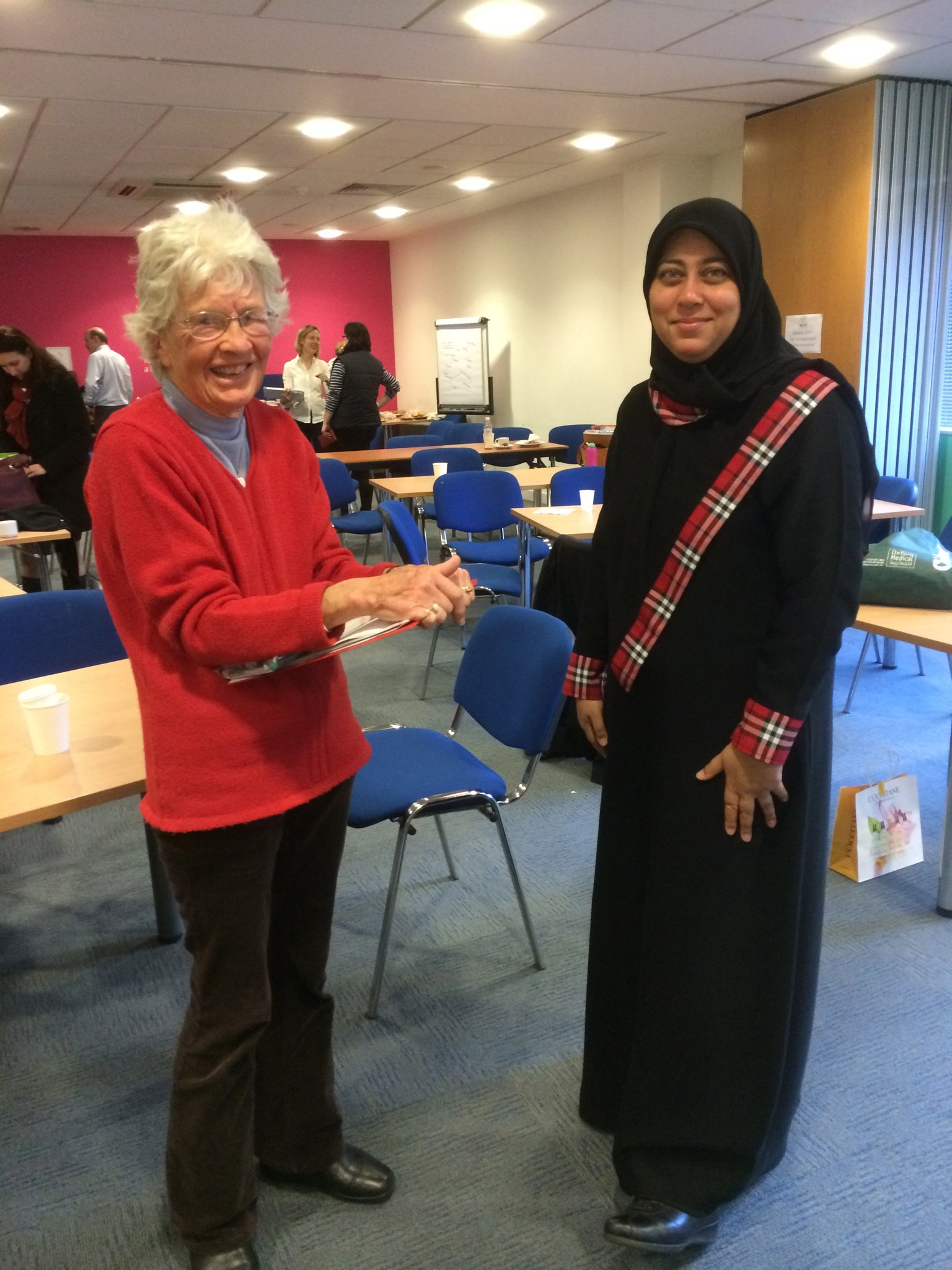 Jane at the NHA's annual Members' Day in 2013 talking to Uzma, a specialist teacher from Oman.