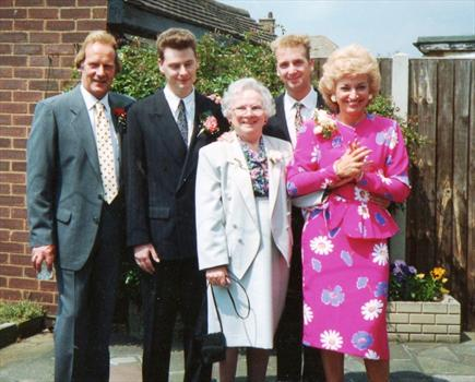 Pretty in pink, with her Mum, Tony and Boys