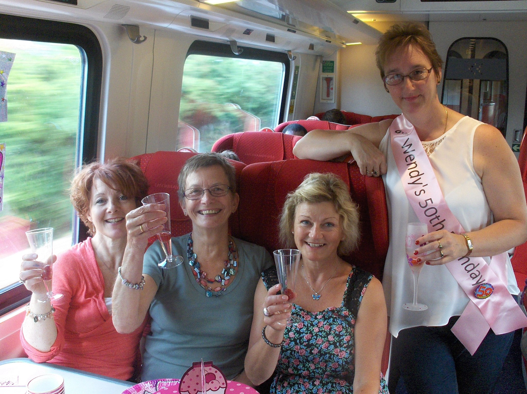 Jess, Sue, Ursula and Wendy on the train to London - July 2013
