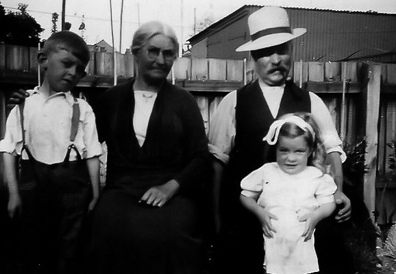 with brother Peter, Pop Fisher and Grandma Alice abt. 1938