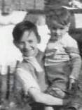 Dad on the left, holding one of his younger brothers, Ged