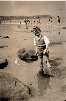 David on the beach, as a child