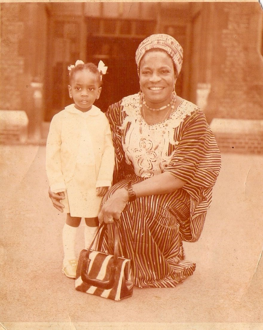Ijeoma as a toddler with her late Mum. The baby of the family.