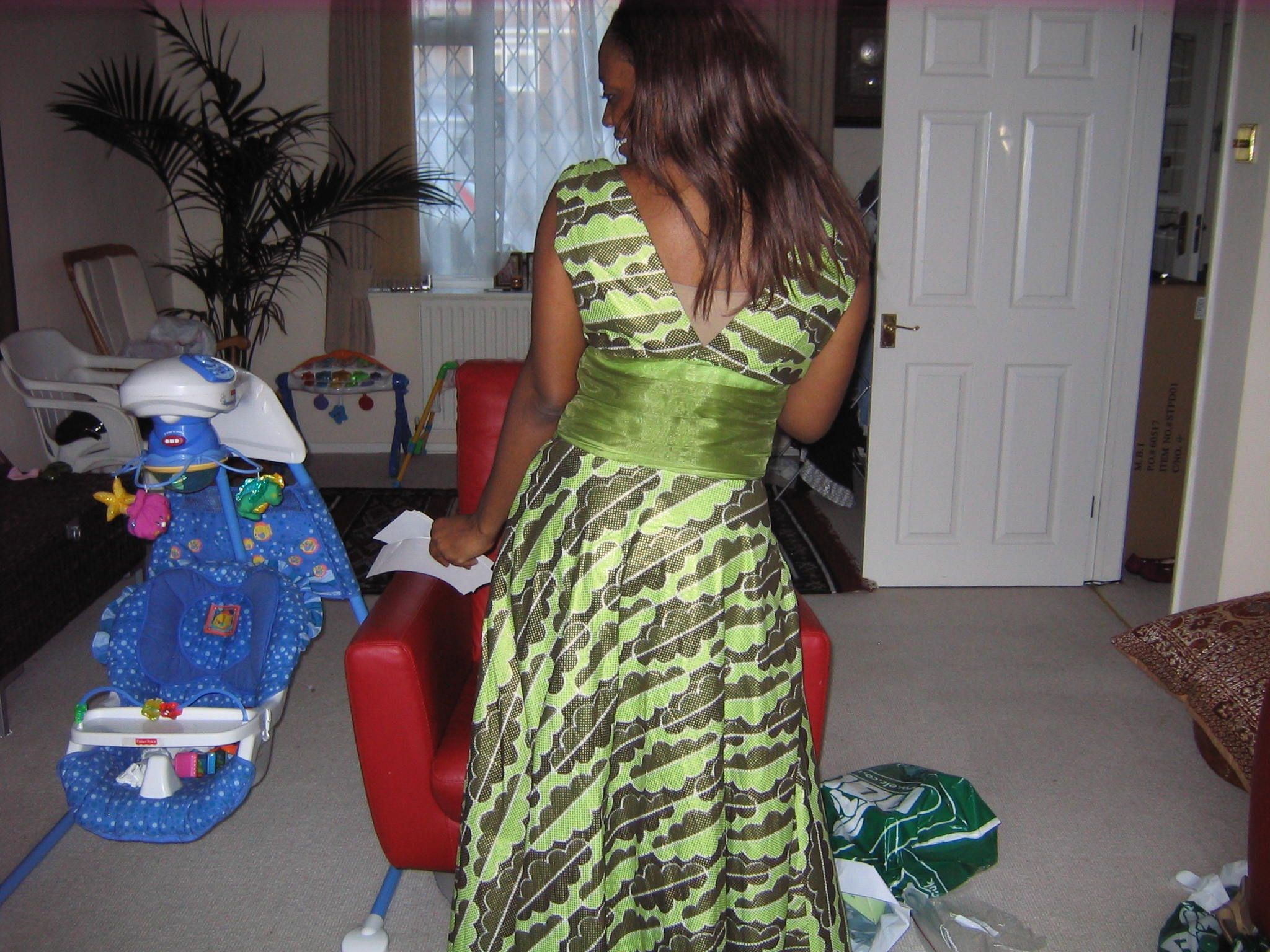 Ije modelling her dress for us