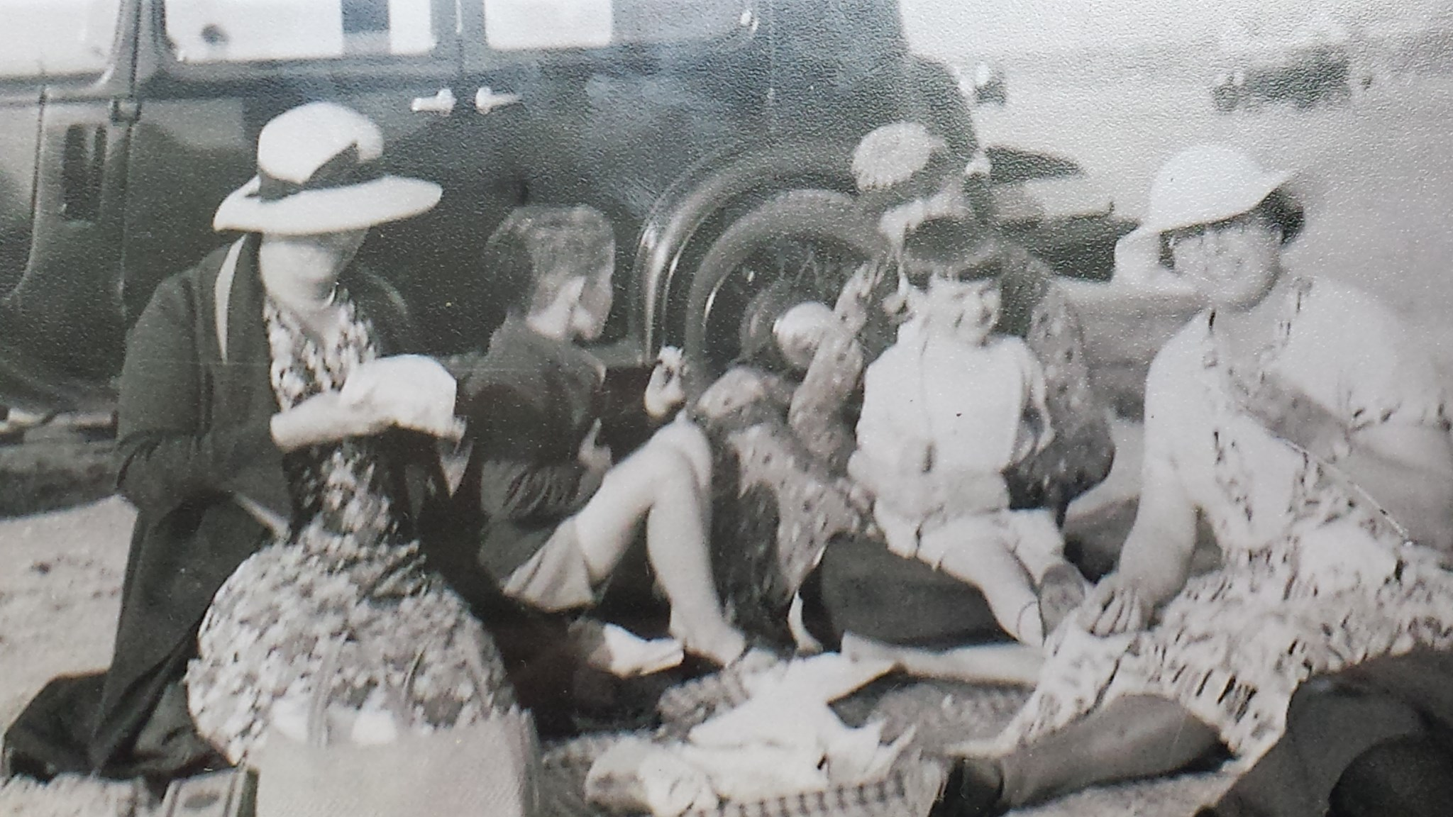 Dad on the beach with the car! He is on the family's maid Florrie's lap, with his mum, brother John and i