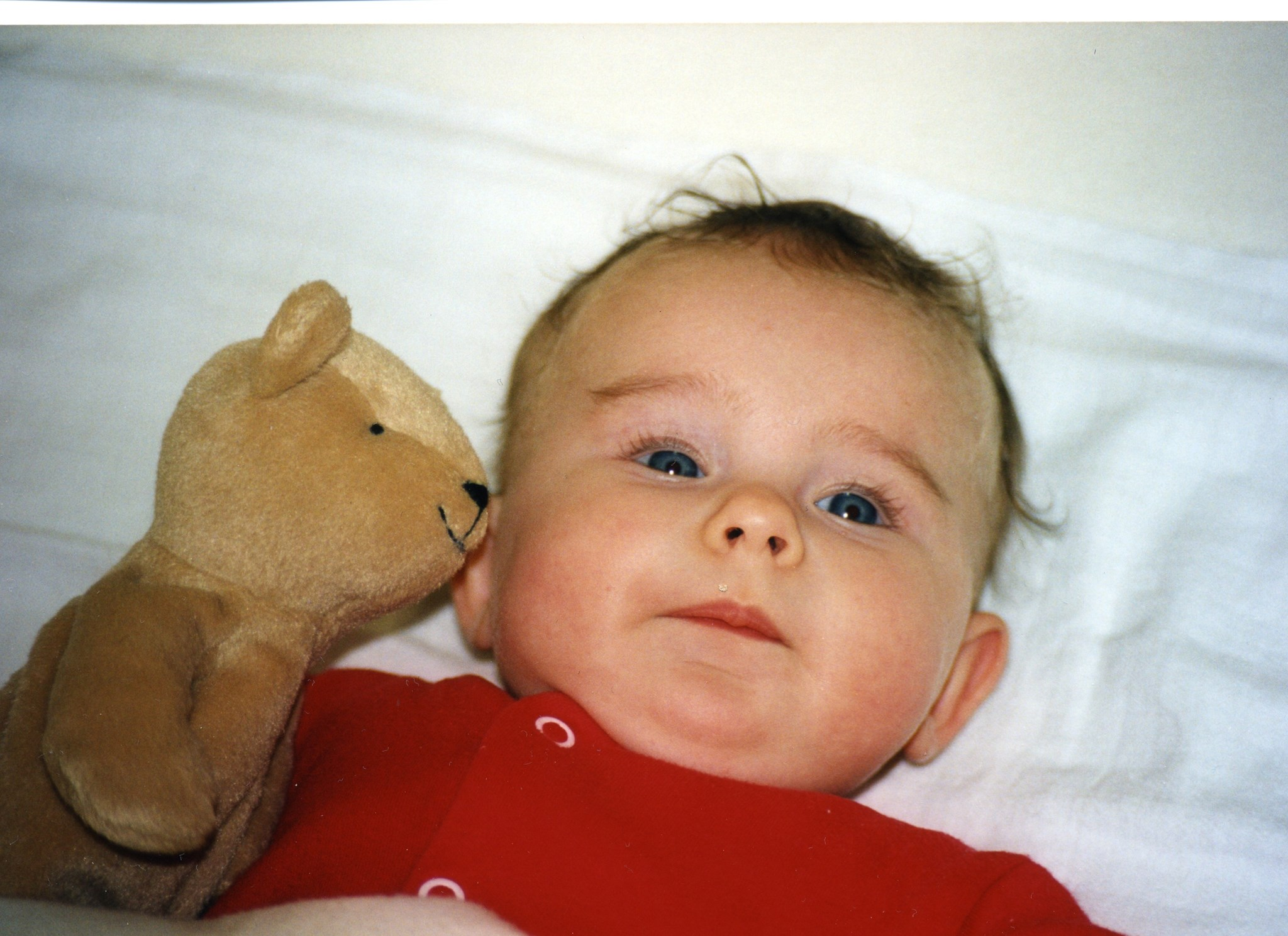 Baby Kara with the imaginatively named 'Teddy', later called Lucie.