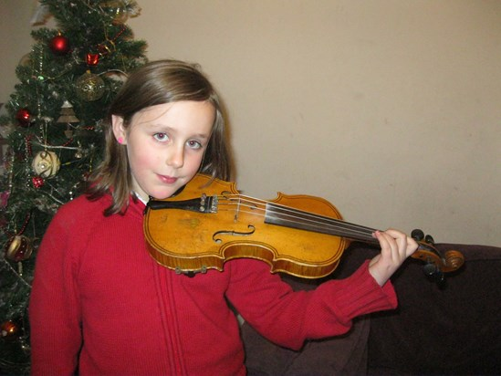 Alice demonstrating the violin for her 'Music Passion project'
