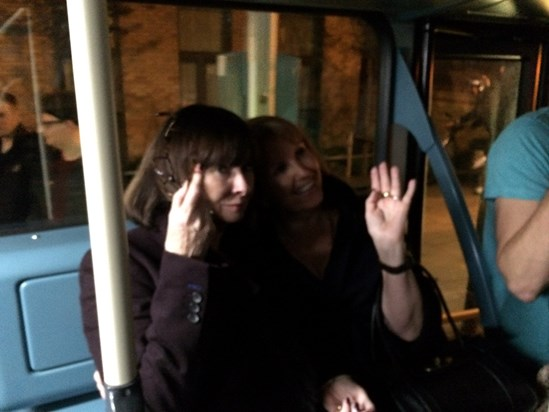 Susan and Angela in the bus luggage rack after a fun night out in London with Mike and Chris .
