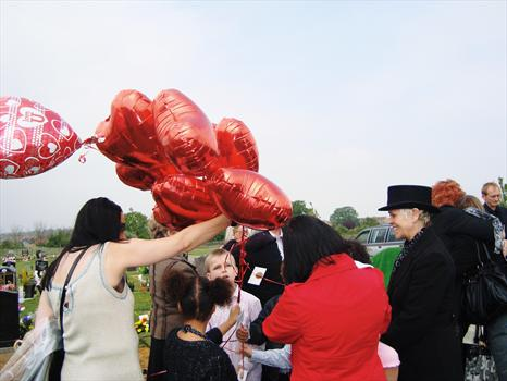 Clair and Rowena, releasing heart shaped balloons for Paul from the children