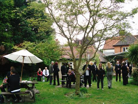 Family and friends chatting in the garden