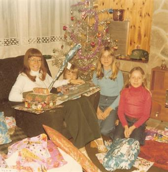 Christmas Day 1977 -Auntie Pat with all her Christmas presents