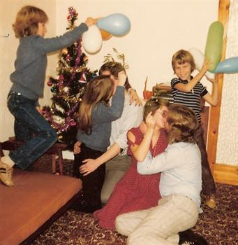 Christmas Day 1979 - Paul's sister Karin having a kissing contest against Uncle Kevin!