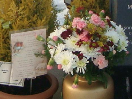 """Paul's """"Christmas Memories"""" card from Clair, Tshequa, Matt & Nicky, with pretty flowers from Jean"""