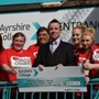 Ayrshire College Social Care students cheque presentation for an outstanding £1510.10.