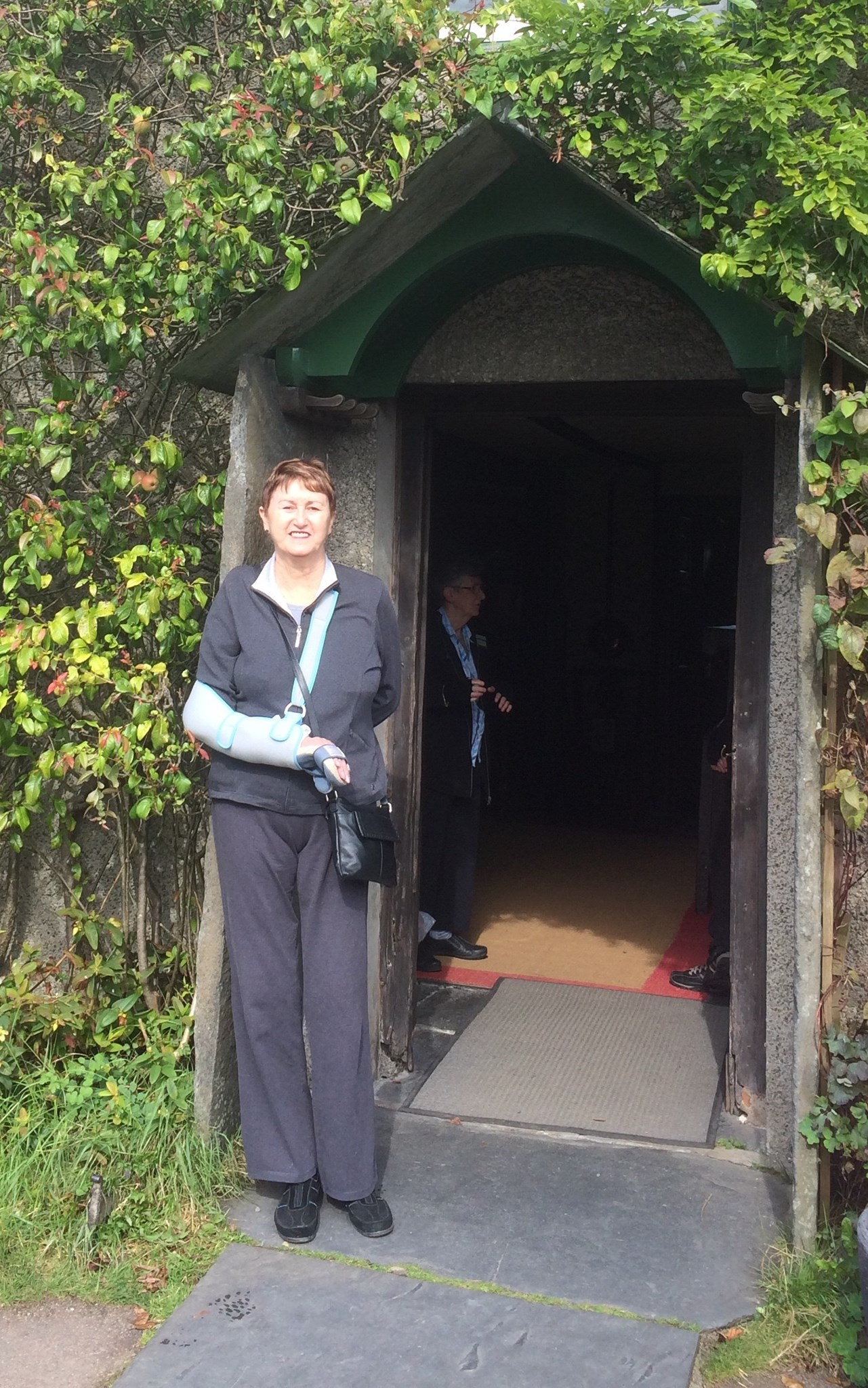 my princess posing in the doorway of Beatrix Potter's house last year