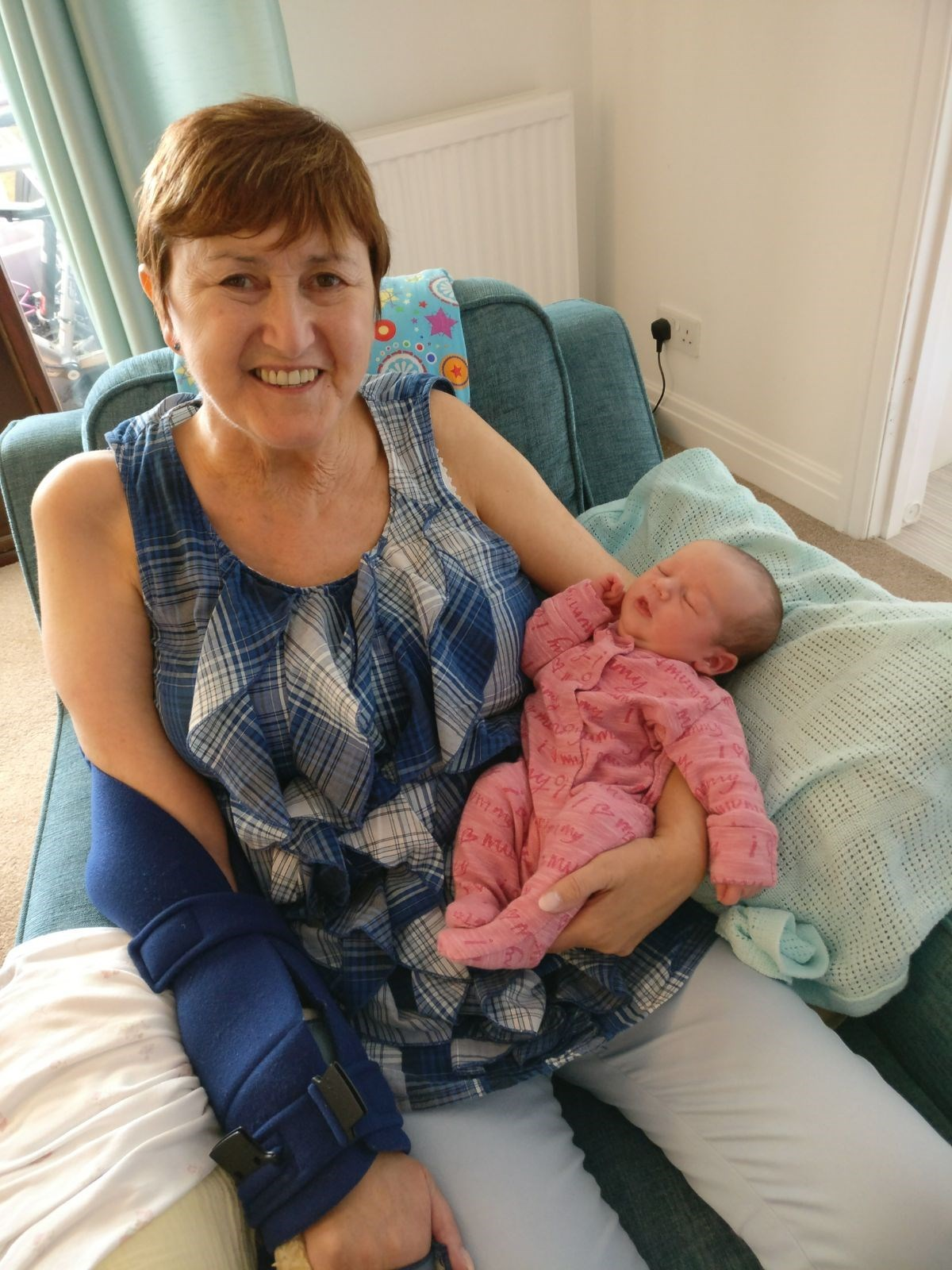 Cuddles with her youngest grandaughter
