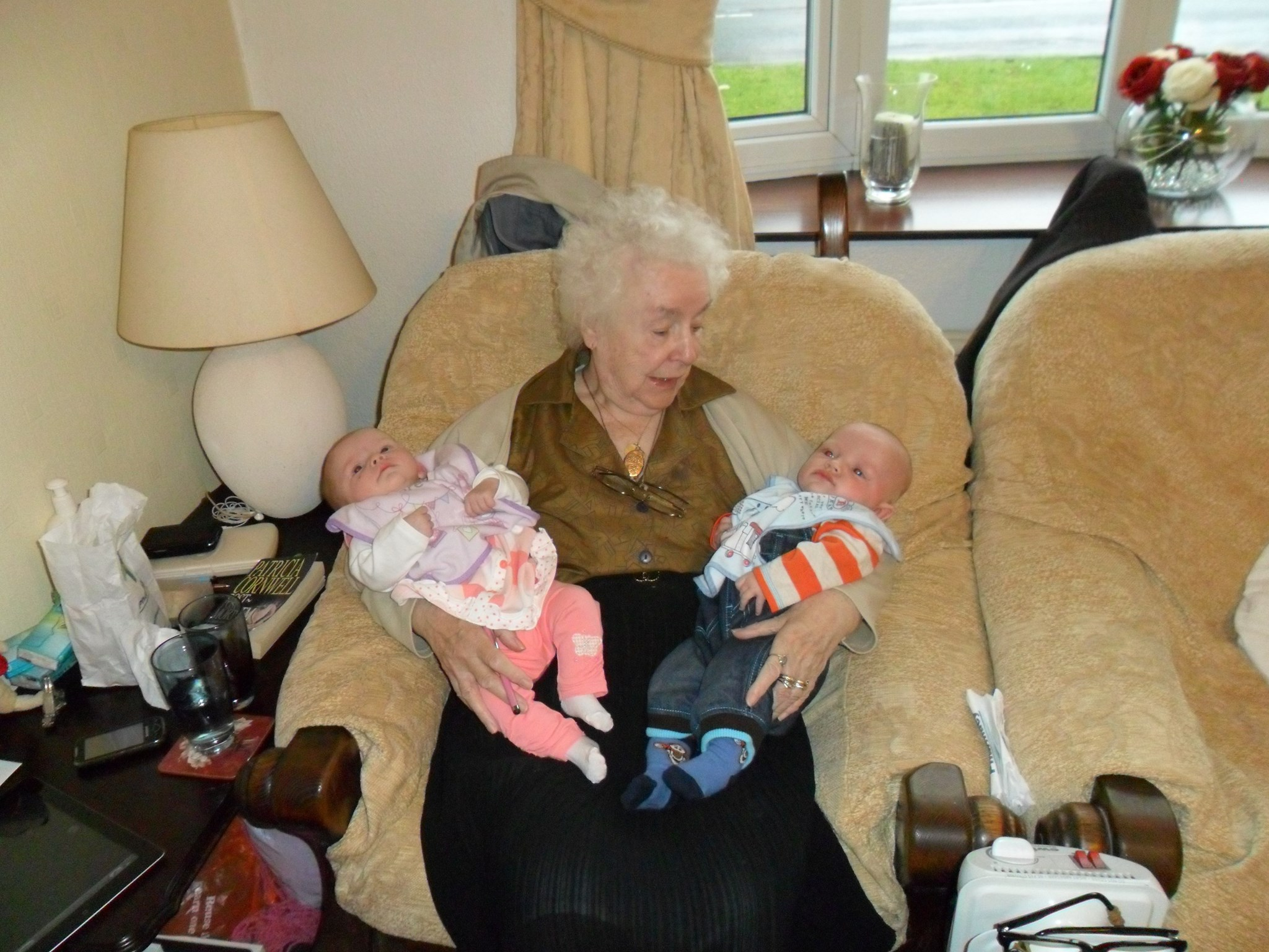 Cuddle with the great-grandtwins