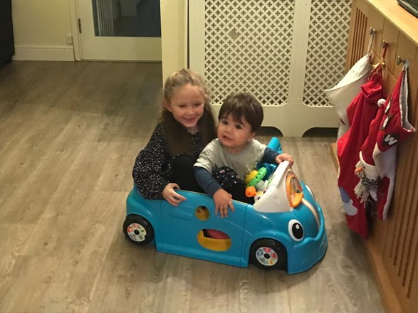 Cousins in a broom broom car