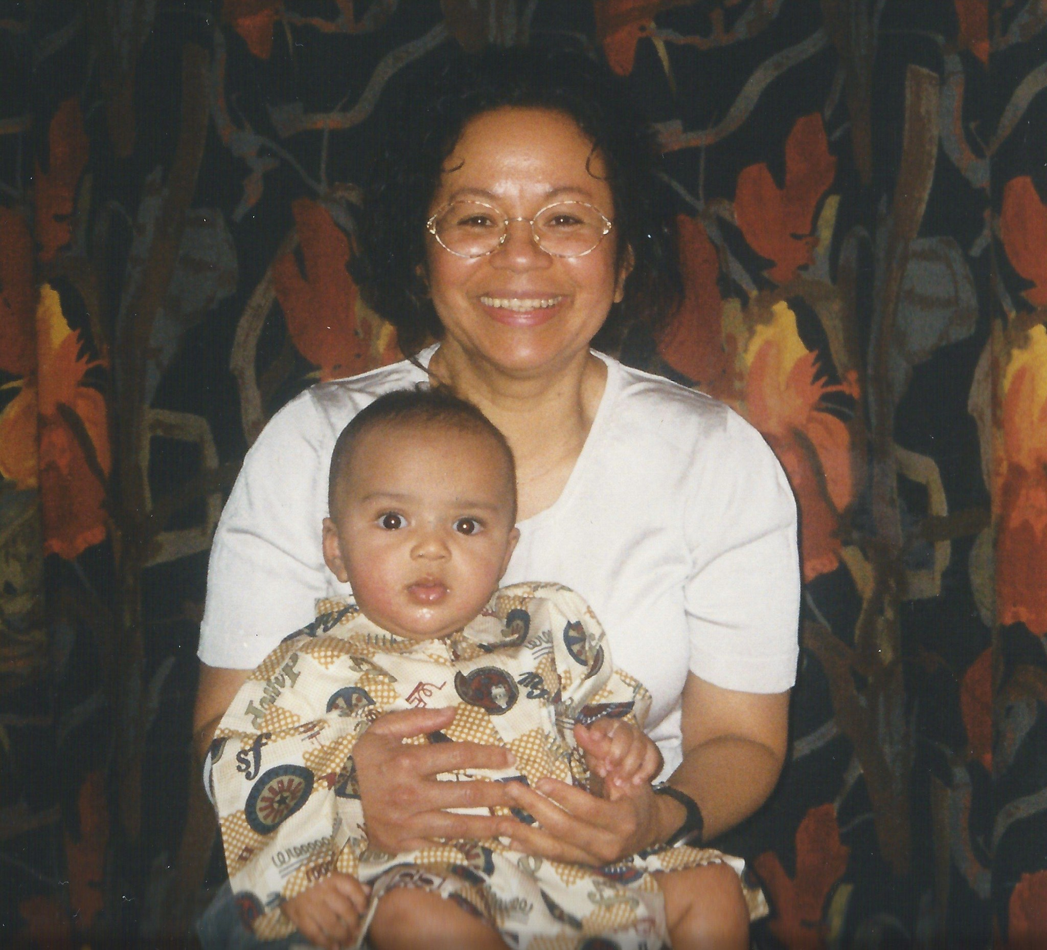 Claudia in Brixton with 6 month old Eke - December 1999