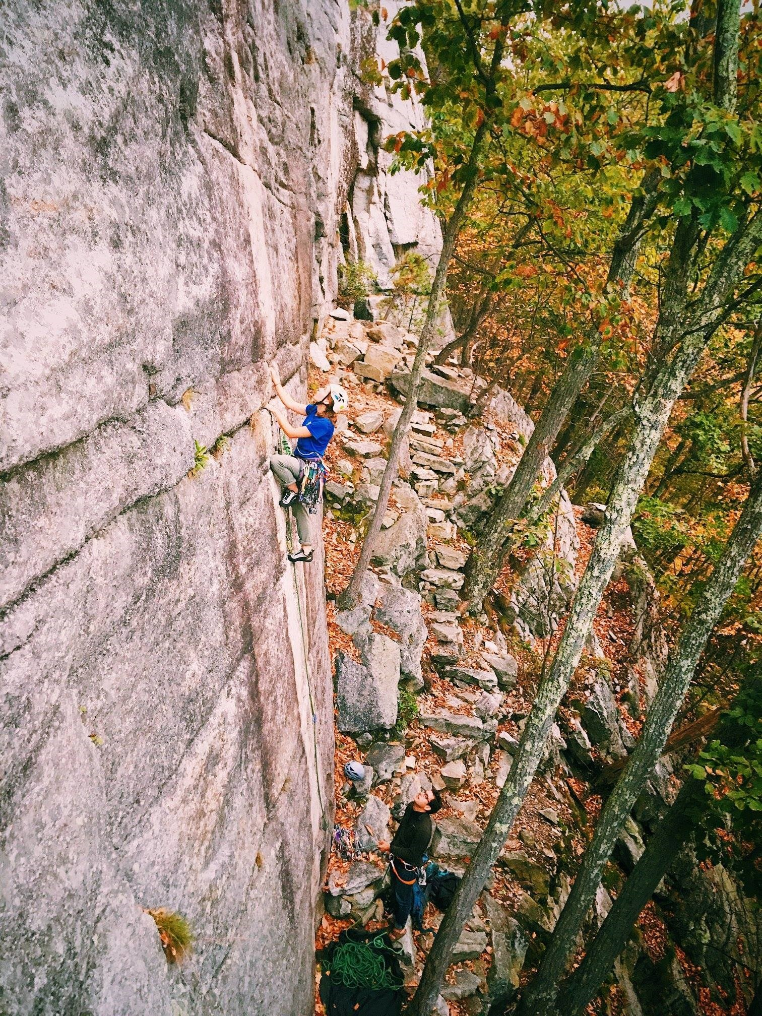 Emily Shertzer with Marco climbing Never Never Land in the Gunks.